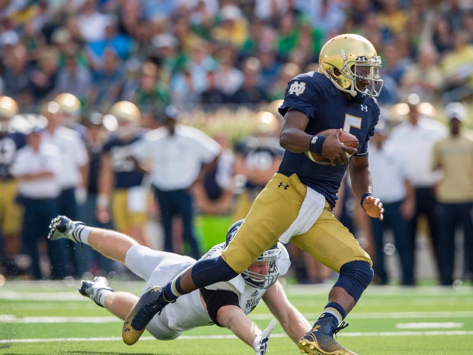 Everett Golson scores one of his TDs. Photo by Matt Cashore