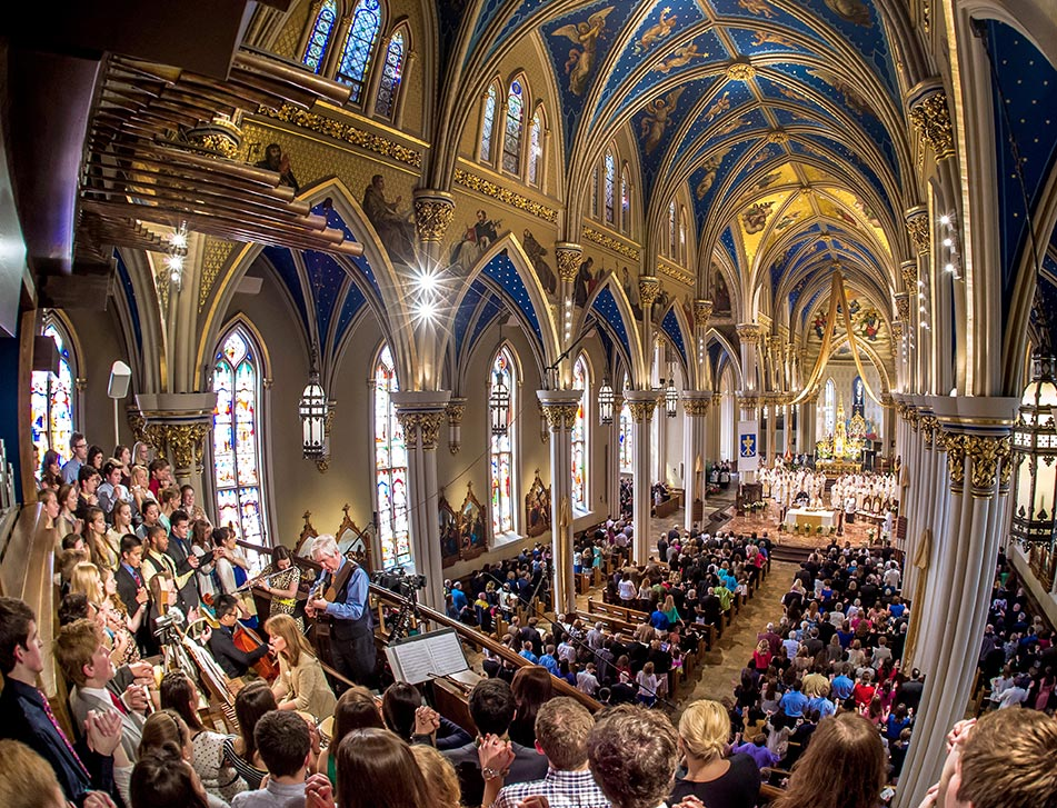 Apr. 26, 2014; Steven Warner and the Folk Choir sing the Our Father at the 2014 Ordination Mass in the Basilica of the Sacred Heart. Photo by Matt Cashore/University of Notre Dame