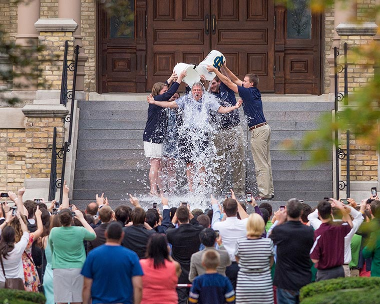 "Aug. 16, 2014; Fr. John Jenkins is doused with ice water as part of the ""ALS Ice Bucket Challenge."" Photo by Matt Cashore/University of Notre Dame"