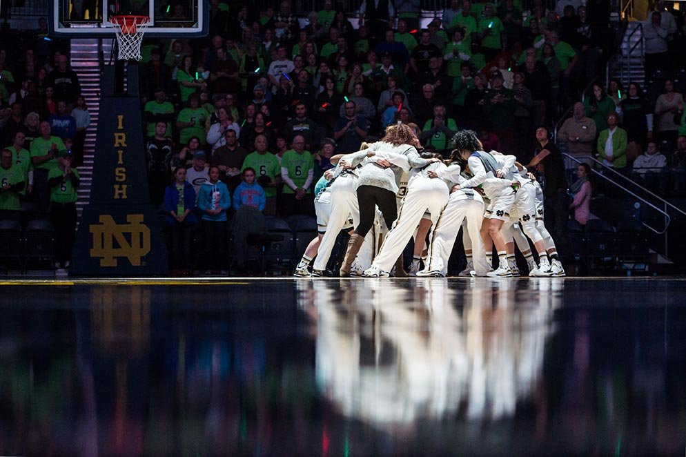 Dec. 21, 2014; The Women's Basketball team gather in a huddle before the game against the St. Joseph's Hawks at the Purcell Pavilion. (Photo by Matt Cashore/University of Notre Dame)