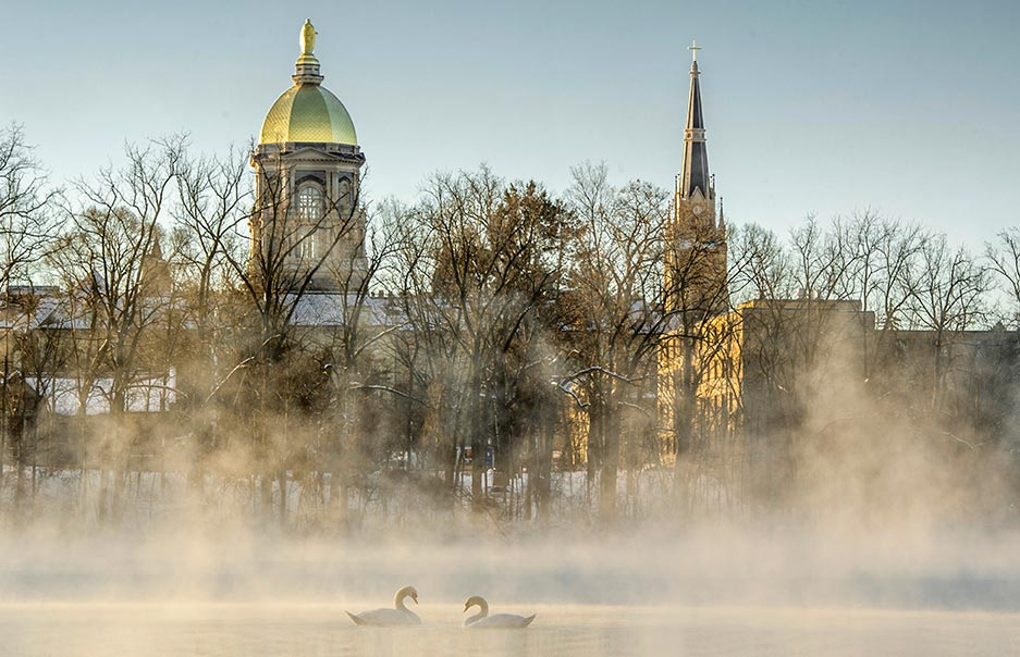 Jan. 13, 2015; Single digit temperatures cause frost to form on the trees and fog to rise on St. Joseph Lake . (Photo by Barbara Johnston/University of Notre Dame)