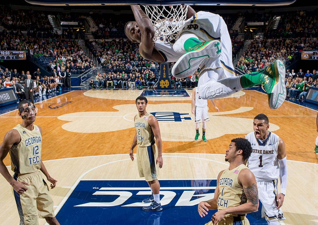 Jan 3, 2015; Jerian Grant (22) hangs on the rim after a dunk in the second half against the Georgia Tech Yellow Jackets at the Purcell Pavilion. Notre Dame won 83-76 in double overtime. (Photo by Matt Cashore)