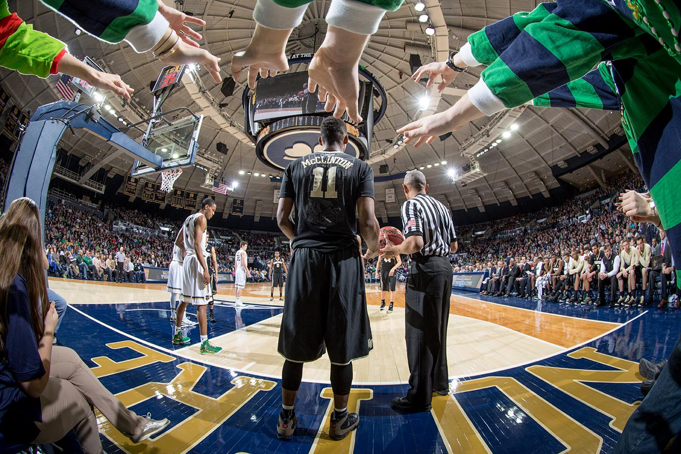 Feb. 17, 2015; The Leprechaun Legion reach out toward Wake Forest forward Greg McClinton (11). (Photo by Matt Cashore)
