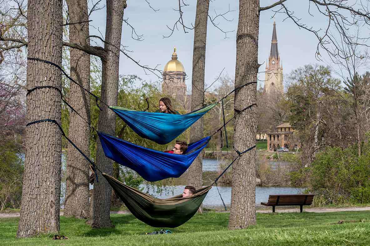 April 29, 2015; Students relax in their hammocks near St. Mary Lake. (Photo by Barbara Johnston/University of Notre Dame)