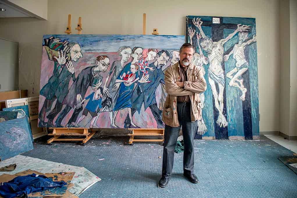 May 5, 2015; Maxim Kantor, renowned Russian artist and Director's Fellow at the NDIAS paints in his studio at Notre Dame. (Photo by Barbara Johnston/University of Notre Dame)