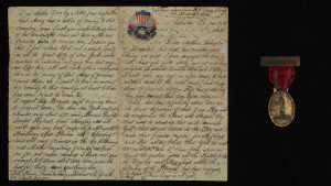 Letter, Thomas Francis McGrath to his mother, January 20, 1863 and Veteran's Badge, Dedication of NY State Monument, Antietam, September 17, 1920.