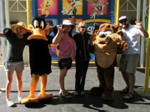 """An obligatory picture with Looney Tunes characters. Here, my friends are signing """"I love you"""" in ASL."""