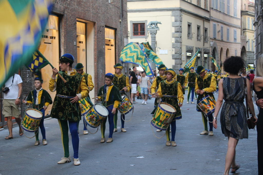 A parade of young people from the contrada Bruco