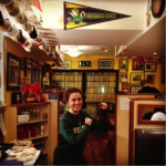 Alex Moulton '13 is pictured next to a Fighting Irish pennant at Scotty's Steakhouse near Galway, Ireland.